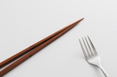 Chopsticks fork. Chopsticks and fork on white background Stock Images