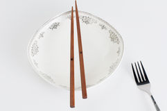 Chopsticks fork. Chopsticks and fork on white background Royalty Free Stock Photos
