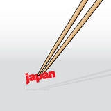 Chopsticks grabbing Japan word Royalty Free Stock Photography