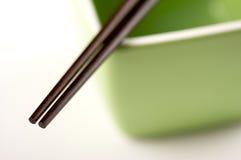 Chopsticks & Green Bowl Stock Images