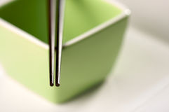 Chopsticks & Green Bowl Royalty Free Stock Image