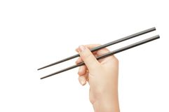 Chopsticks in a hand Royalty Free Stock Images