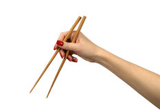 Chopsticks in a hand. Isolated on white Stock Images