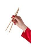 Chopsticks on hand Stock Image