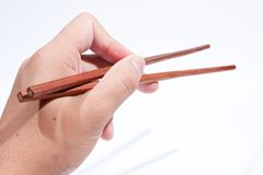 Chopsticks are the hand grip. Royalty Free Stock Photo