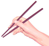Chopsticks in hand Royalty Free Stock Image
