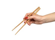 Chopsticks in a hand1 Stock Photos