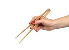 Chopsticks in a hand1. Chopsticks in a hand,isolated on white Stock Photos