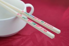 Chopsticks with hieroglyphics on the red Stock Photography