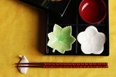 Chopsticks holder and chopsticks and nest of boxes Stock Photography