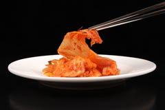 Chopsticks holding kimchi - Series 2 Stock Photography