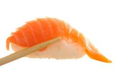 chopsticks holding sushi Stock Images