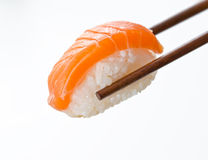 Chopsticks holding sushi Royalty Free Stock Image
