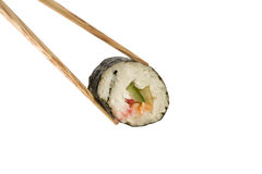 Chopsticks holding a Sushi roll Royalty Free Stock Photo