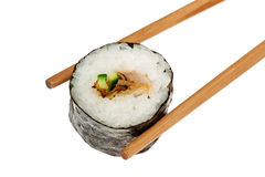 Chopsticks holding sushiroll Stock Images