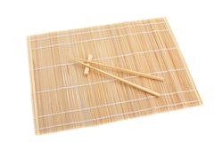 Chopsticks isolated on bamboo mat Royalty Free Stock Image