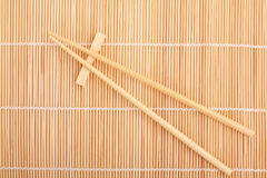 Chopsticks isolated on bamboo mat Royalty Free Stock Photography
