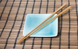 Chopsticks and japanese style dish Stock Photos