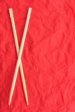 Chopsticks lay on a red napkin Stock Photo