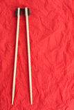 Chopsticks lay on a red napkin Royalty Free Stock Photography