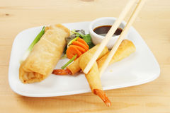 Chopsticks lift a prawn Stock Image