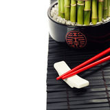 Chopsticks and a lucky bamboo plant Stock Photography