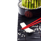 Chopsticks and a lucky bamboo plant Royalty Free Stock Photography