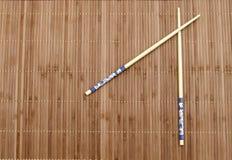 Chopsticks on the mat Royalty Free Stock Photo