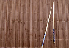 Chopsticks on the mat Royalty Free Stock Photography