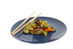 Chopsticks and mixed grilled vegetables Royalty Free Stock Image