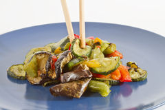 Chopsticks and mixed grilled vegetables Stock Photography