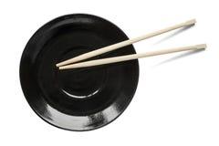 Chopsticks na talerzu Zdjęcia Stock