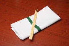 Chopsticks and napkin Stock Images