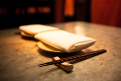 Chopsticks and Napkins. Chopsticks on Japanese Restaurant Table royalty free stock images