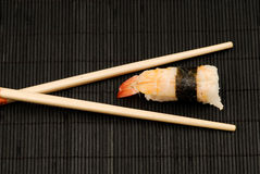 Chopsticks and nigiri sushi Royalty Free Stock Images