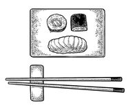 Chopsticks Nigiri Sushi with fish, rolls on wood board. Royalty Free Stock Image