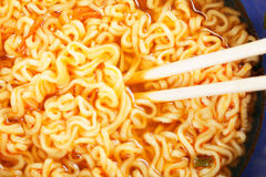 Chopsticks in noodle broth royalty free stock images