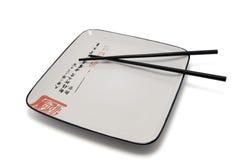 chopsticks opróżniają talerza Zdjęcie Stock