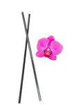 Chopsticks with orchid Stock Image