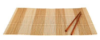 Chopsticks over a bamboo mat Royalty Free Stock Images