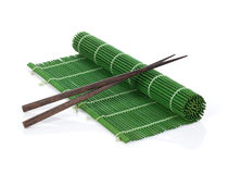 Chopsticks over bamboo mat Stock Images