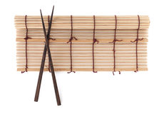Chopsticks over bamboo mat Royalty Free Stock Image