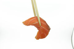 Chopsticks pinch fresh salmon sushi and wasabi Stock Images
