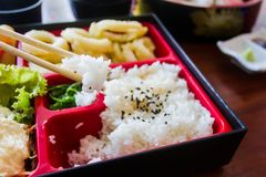 Chopsticks are pinch rice on bento set. Japanese food style. Stock Photo