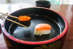 Chopsticks are pinch sushi shrimp eggs. Japanese food style. Stock Photography