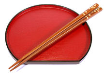 Chopsticks and plate. Chopsticks and traditional Japanese plate Stock Images