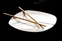 Chopsticks and plate Stock Photos