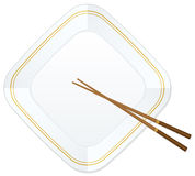 Chopsticks and plate Royalty Free Stock Image