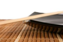 Chopsticks on the plate. Japananese style plate on bamboo rug Stock Photo