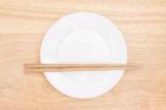 Chopsticks and plate Stock Photo